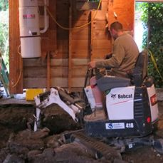 micro excavator digging under home